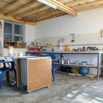 Behind the lab is our kitchen, complete with oven, stove, refrigerator, and fully-stocked pantry.