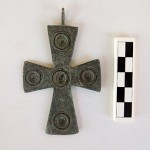 This complete bronze cross appears to have been decorated.